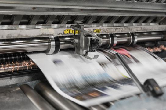 Printing machine producing newspaper